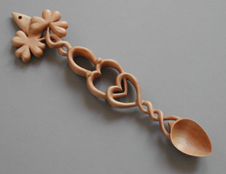Welsh Lovespoon carved from maple with heart shaped clovers, inter-twining vines, horseshoe and hearts.